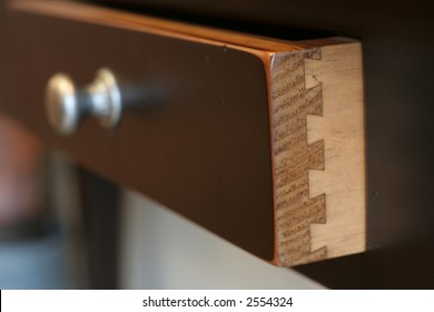 Details of a dovetailed joint on a drawer.