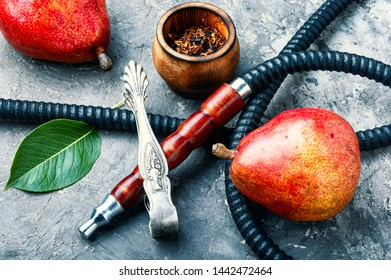 Details of the eastern kalian.Hookah with pear flavor.Smoking pear tobacco