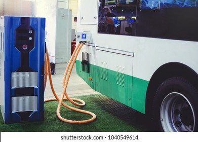 Details of electric vehicle charging city bus transport. Green and renewable energy sources.