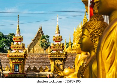 The details of the exterior of the temples near the most important national monument in Laos- Pha That Luang in Vientiane. Pha That Luang is a symbol of both the Buddhist religion and Lao sovereignty.