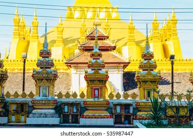 The details of the exterior  of the temples right near the most important national monument in Laos - Pha That Luang in Vientiane. Pha That Luang