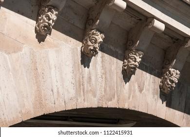 details of faces in pont neuf (new bridge) of Paris