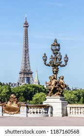 Details of the famous Pont Alexandre III bridge in central Paris with the Eiffel Tower in the distance. Paris, France