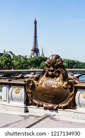 Details of the famous Pont Alexandre III bridge in central Paris with Eiffel Tower in the distance. Paris, France