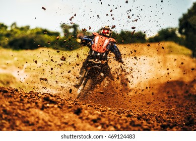 Details of flying debris during an acceleration in a motocross dirt track