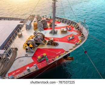 Details of forward cargo ship and equipment, rope winch,anchor winch, onboard for alongside at industrial port.