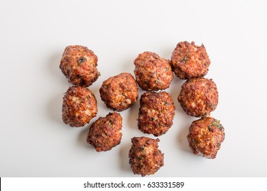 Details of fresh fried meatballs on a white background