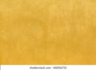 Details of golden texture background. Gold color painted on cement wall  for background and wallpaper
