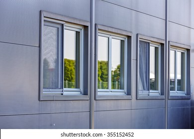 Details of gray facade made of aluminum panels on industrial building