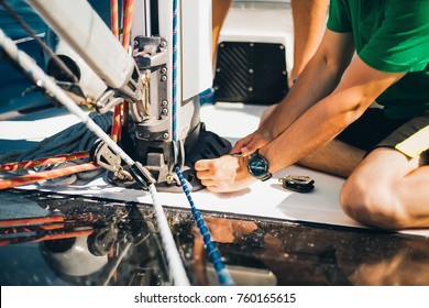 Details hands with watch, man works, yachting, summer holidays, sunrise, attractive, sunglasses, shorts, tan, skin care, resting, regatta, emotions, thinking, relax, hand watch