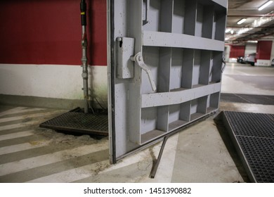 Details with the heavy metal doors of a nuclear explosion shelter (fallout shelter), four stories below ground in a deep underground parking lot.