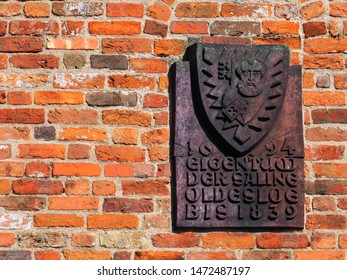 """Details of Holsten Gate in Lubeck, Germany. Memorial plaque to the Oldesloer Saline. Text """"1694 property of the Saline Oldesloe until 1839"""""""