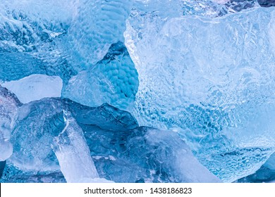 Details of iceberg fragments floating in the arctic sea. Blue glacial ice calved from the g;aciers of Svalbard, a Norwegian archipelago between mainland Norway and the North Pole