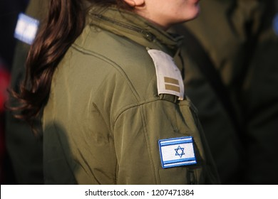 Details with the Israeli flag on a woman military medic uniform