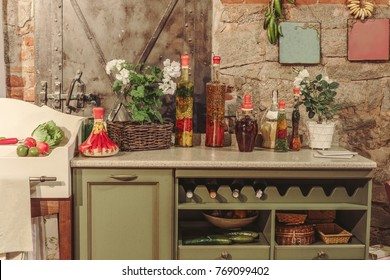details kitchen interior. Bottles with oil, flowers, paintings on the wall