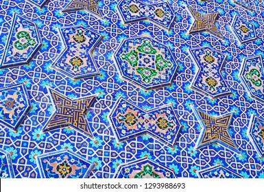 Details of the masterpiece tiling on wall of the South portal of Jameh Mosque, Islamic patterns neighbor with relief porcelain decor, Isfahan, Iran.