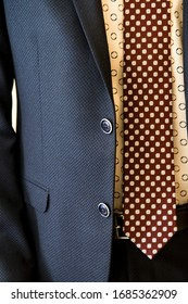 Details of men's clothing, tie jacket and shirt.