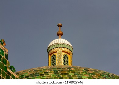 Details of minaret at the Mausoleum of Apak Khoja and Tomb of the Fragrant Concubine in Kashgar, or Kashi, Xinjiang, China against blue skies with copy space.