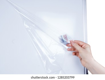 Details of the Mobile Whiteboard. Removing the protective film from the board.  Isolated on white background