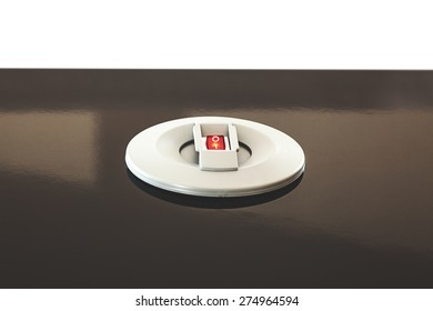 Details of a modern electric switch built in table.