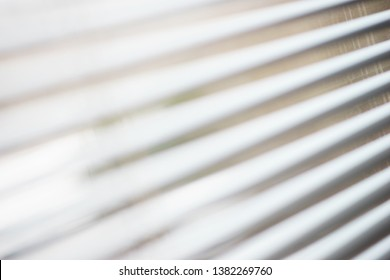 Details of the modern interior - blinds on the window. Abstract background. Modern business office and interior style. Soft focus and beautiful bokeh.
