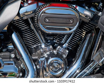 Details of motorcycle bike engine and exhaust in shiny chrome reflection
