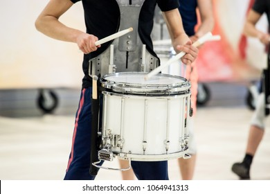 Details from a music, show and marching band. Playing musicians with percussion instruments during a show training