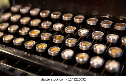 Details of an old fashioned typewriting machine. A typewriter is a mechanical or electromechanical machine for writing characters similar to those produced by printer's movable type.