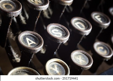 Details of an old retro typewriter, vintage style, dusty surfaces.