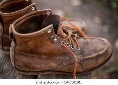 Details on a pair of old leather shoes.