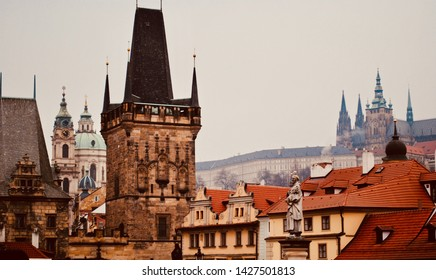 "Details from the Prague, (Praha) Czech Republic ""the City of a Hundred Spires,"" skyline including red roofs, the Charles Bridge, Prague Castle, Strahov Monastery, and church of St. Francis of Assisi."