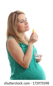 Details of a pregnant woman with a glass of milk and cheese isolated on white background.