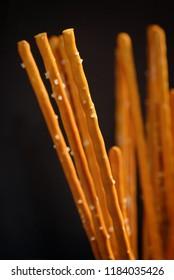 Details of Pretzel sticks on black background