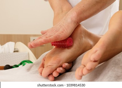 Details of professional massotherapy - Feet massage with special tools.