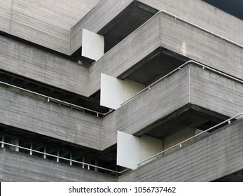 details of railings and balconies on an old brutalist concrete building