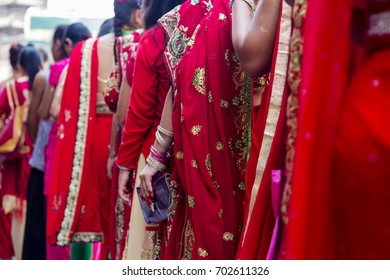 The details of Red sarees in Hartalika Teej - holiday celebrated mostly by girls and women with songs, dancing and prayer rituals, usually wearing red saree.