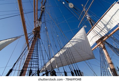 Details of rigging of sailboat with blue sky in the background