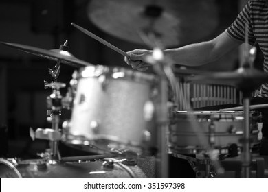 Details of a rock drummer playing