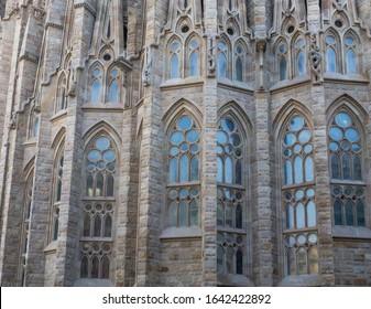 Details of Sagrada Familia Basílica old architecture colorful windows by Gaudi. Spain, Barcelona.