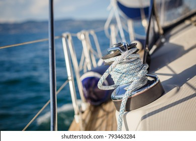 details of sailing equipment on a boat when sailing on the water in a sunny day