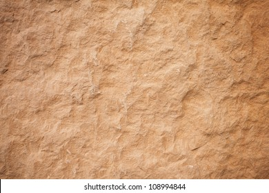Details of sand stone texture, closeup shot of rock surface with vignette at cover and bright spot at centre, idea for background or backdrop.