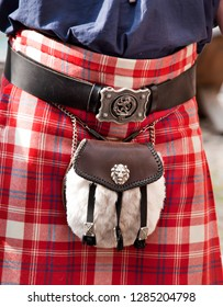 Details of Scottish kilt for a man with leader belt and drinking bottle