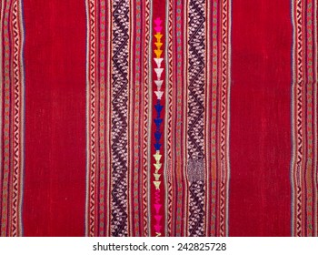 Details shot of indian fabric with colorful pattern.