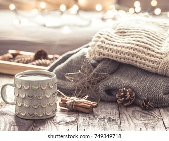 Details of still life in the home interior living room. Beautiful tea Cup and shoes on wooden background . Cosy autumn-winter concept