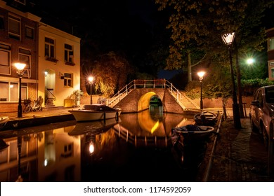 Details of streets, houses, alleys and canals in the old town of Alkmaar in North Holland. Beautifully illuminated city with monuments and locations, photographed in the evening and the night.