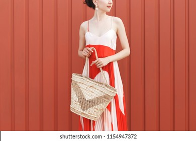 Details of stylish woman s summer outfit. Red and white midi silk dress ec6b51384fc9b
