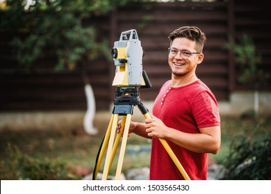 Details of survey engineer using and working with total station theodolite at landscaping project