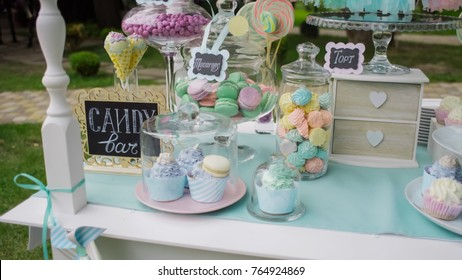 Details of a tasty candy bar with jugs of sweets, cookies and marshmallows, Candy, waffles, cookies and macaroons , sweets concept