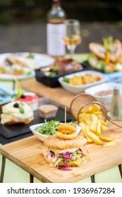 details of tasty hamburger, at restaurant, natural light