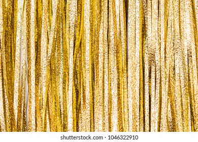 Details and texture from golden tinsel strips, christmas or festive decoration